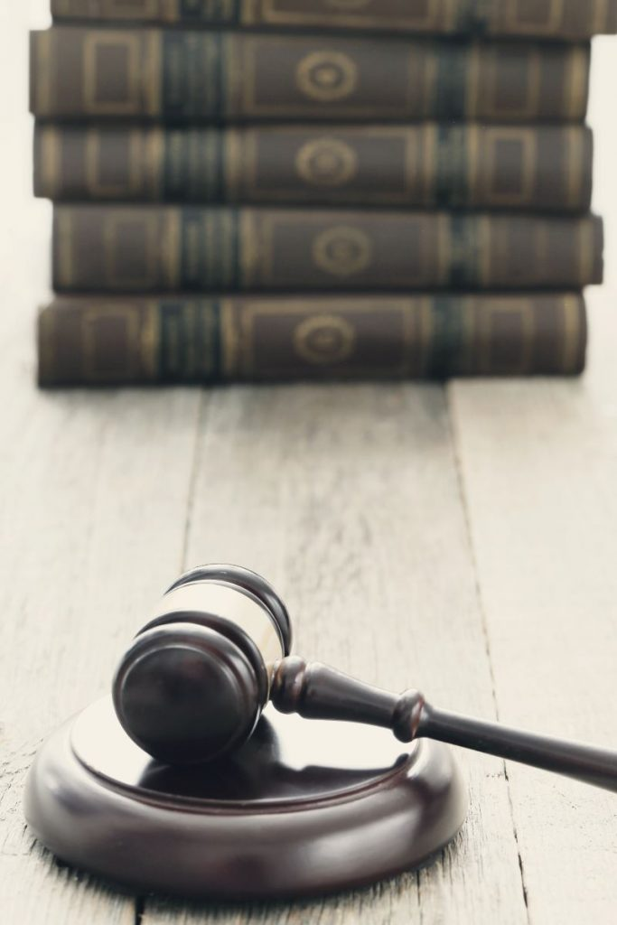 Gavel in front of a stack of law books